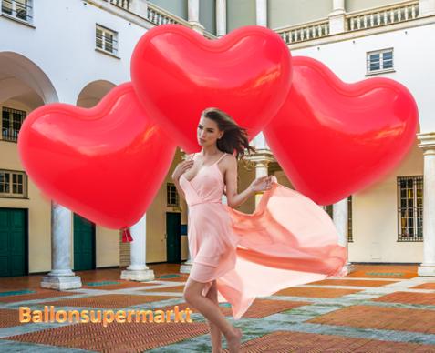 Grosse-rote-Herzluftballons-mit-Ballongas-Helium-zur-Hochzeit